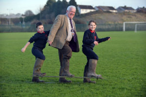 Westmeath Co. Council Leas-Cathaoirleach, Cllr. Tom Farrell with pupils from Doora National school, County Clare, Leon Guerin and Lianda McGuire try out the Upcycled Wellies equipement which got an Honourable Mention for the school in the upcycling completion Photo: Ray Ryan